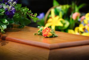 Casket of D's dad. My lapel flower.
